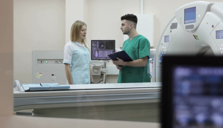 r-and-nurse-discussing-diagnosis-a-scanning-room-with-computers-and-monitors-next-to-the-ct-scan-room-in-a-new-modern-cancer-treatment-hospital_rjwl4ml5l_thumbnail-full01